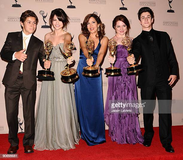 Jake T Austin Selena Gomez Maria CanalsBarrera Jennifer Stone and David Henrie pose for photos in the press room at the 2009 Creative Arts Emmy...