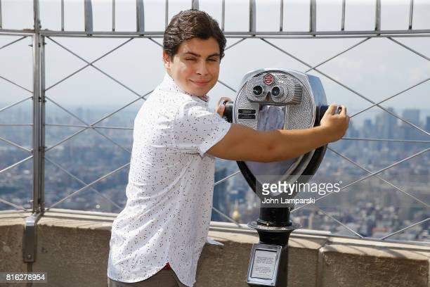 Jake T Austin Stewart poses as The Emoji Movie celebrates World Emoji Day at Empire State Building at The Empire State Building on July 17 2017 in...