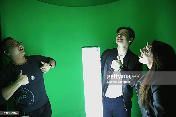 Jake T Austin takes a photo in the 360 snowglobe Photobooth at Tinashe LIVE Z100 Jingle Ball Viewing Party at Samsung 837 on December 9 2016 in New...