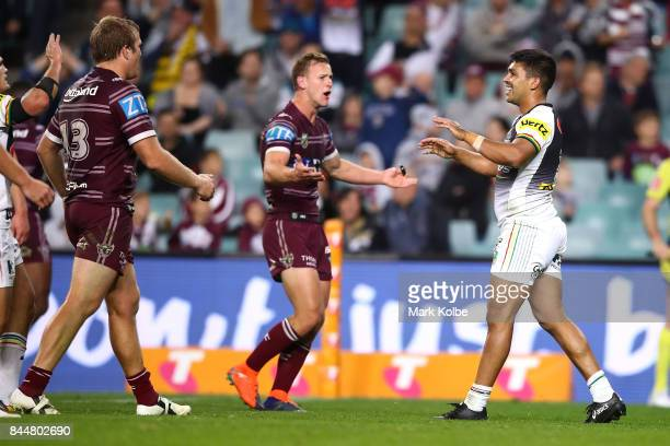 Jake Trbojevic and Daly CherryEvans of the Sea Eagles appeal to referee Gerard Sutton as Tyrone Peachey of the Panthers celebrates scoring a try...