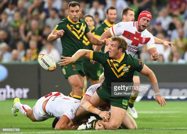 Jake Trbojevic of Australia passes whilst being tackled during the 2017 Rugby League World Cup match between the Australian Kangaroos and England at...
