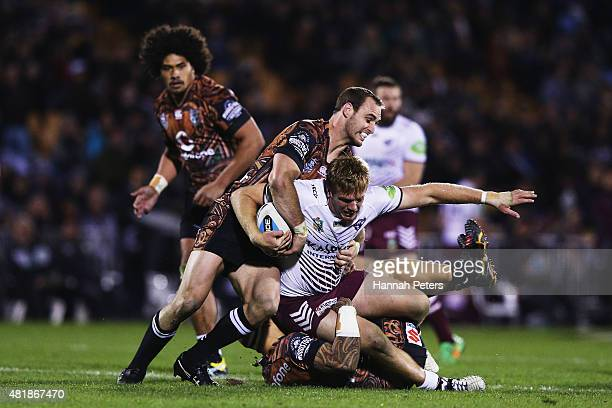 Jake Trbojevic of Manly is brought down during the round 20 NRL match between the New Zealand Warriors and the Manly Sea Eagles at Mt Smart Stadium...