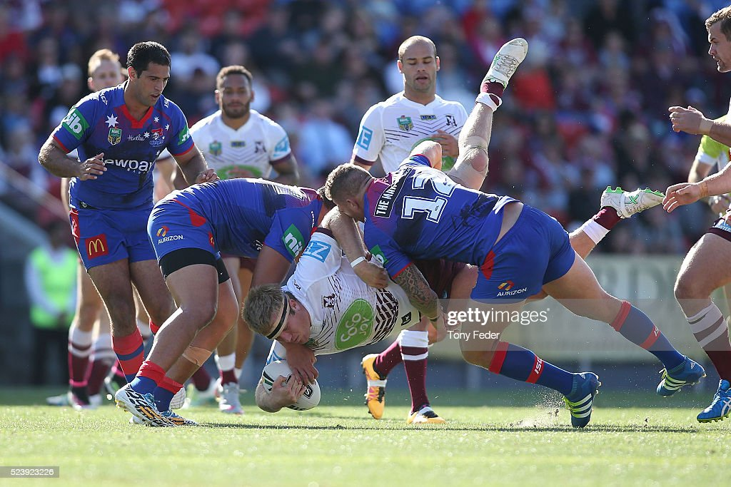 Jake Trbojevic of Manly is tackled by the Knights defence during the round eight NRL match between the Newcastle Knights and the Manly Sea Eagles at Hunter Stadium on April 25, 2016 in Newcastle, Australia.