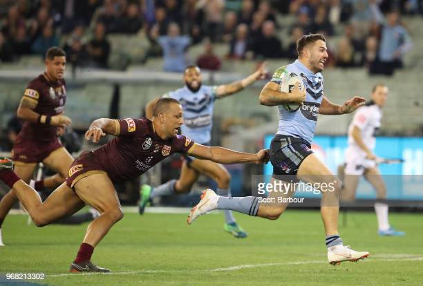 Jake Trbojevic of the Blue runs away to score a try during game one of the State Of Origin series between the Queensland Maroons and the New South...