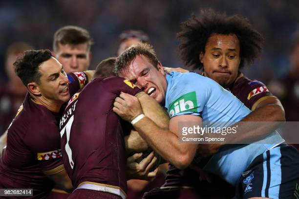 Jake Trbojevic of the Blues is tackled during game two of the State of Origin series between the New South Wales Blues and the Queensland Maroons at...