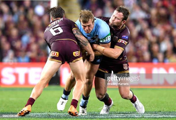Jake Trbojevic of the Blues takes on the defence during game three of the State of Origin series between the Queensland Maroons and the New South...