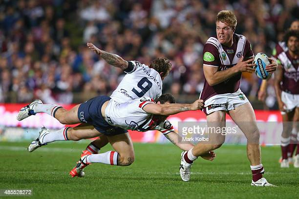Jake Trbojevic of the Eagles looks to pass as he makes a half break during the round 25 NRL match between the Manly Warringah Sea Eagles and the...