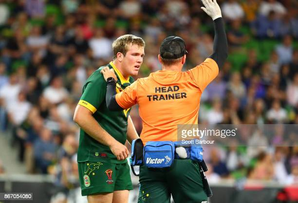 Jake Trbojevic of the Kangaroos leaves the field injured during the 2017 Rugby League World Cup match between the Australian Kangaroos and England at...