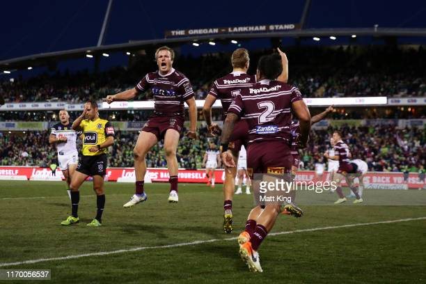 Jake Trbojevic of the Sea Eagles celebrates victory with team mates at the end of the round 23 NRL match between the Canberra Raiders and the Manly...