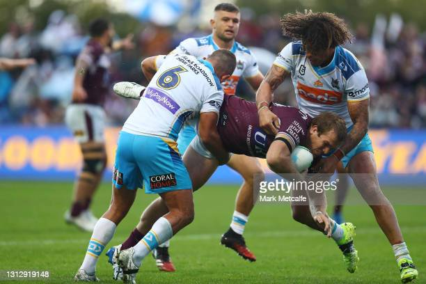 Jake Trbojevic of the Sea Eagles is tackled by Ashley Taylor and Kevin Proctor of the Titans during the round six NRL match between the Manly Sea...