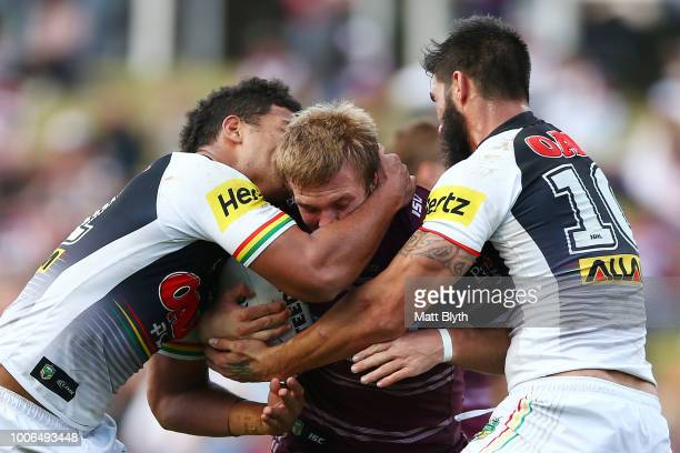 Jake Trbojevic of the Sea Eagles is tackled during the round 20 NRL match between the Manly Sea Eagles and the Penrith Panthers at Lottoland on July...
