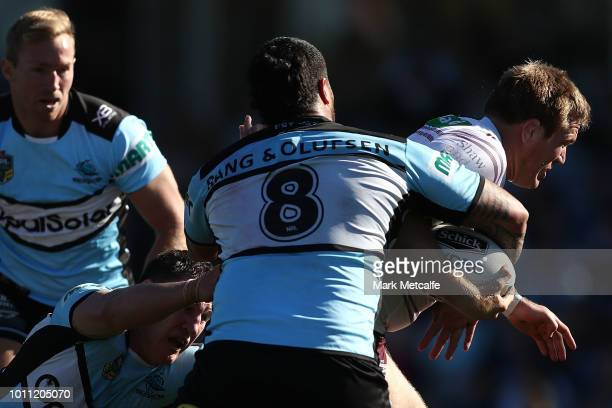 Jake Trbojevic of the Sea Eagles is tackled during the round 21 NRL match between the Cronulla Sharks and the Manly Sea Eagles at Southern Cross...