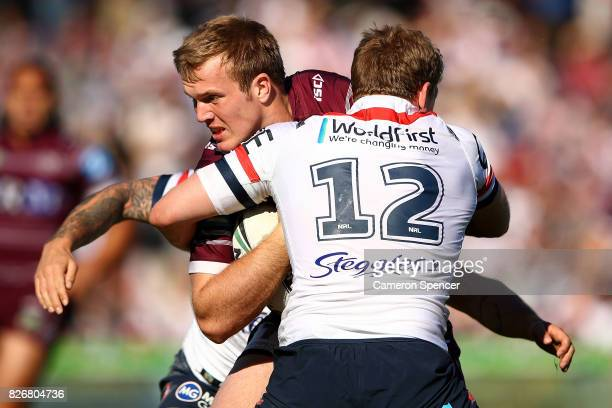 Jake Trbojevic of the Sea Eagles is tackled during the round 22 NRL match between the Manly Warringah Sea Eagles and the Sydney Roosters at Lottoland...