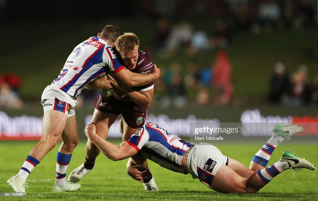 Jake Trbojevic of the Sea Eagles is tackled during the Round eight NRL match between the Manly-Warringah Sea Eagles and the Newcastle Knights at Lottoland on April 27, 2018 in Sydney, Australia.