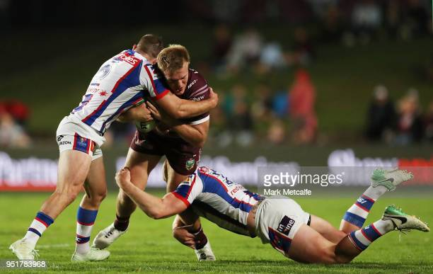 Jake Trbojevic of the Sea Eagles is tackled during the Round eight NRL match between the ManlyWarringah Sea Eagles and the Newcastle Knights at...