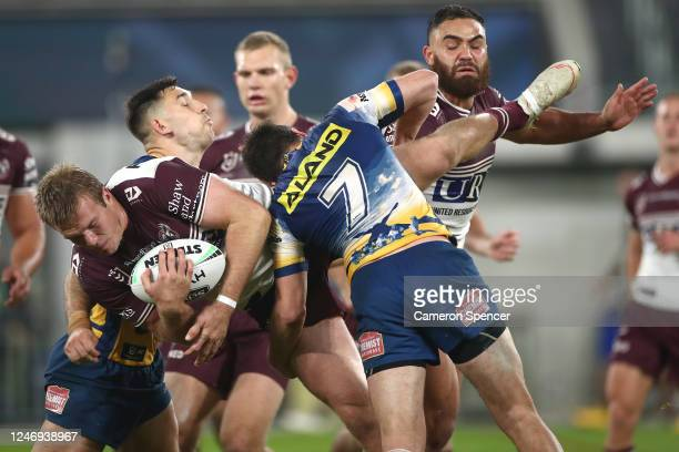 Jake Trbojevic of the Sea Eagles is tackled during the round four NRL match between the Parramatta Eels and the Manly Sea Eagles at Bankwest Stadium...
