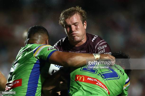 Jake Trbojevic of the Sea Eagles is tackled during the round four NRL match between the Many Sea Eagles and the Canberra Raiders at Lottoland on...