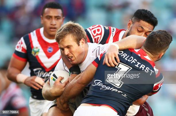 Jake Trbojevic of the Sea Eagles is tackled during the round nine NRL match between the Sydney Roosters and the Manly Warringah Sea Eagles at Allianz...