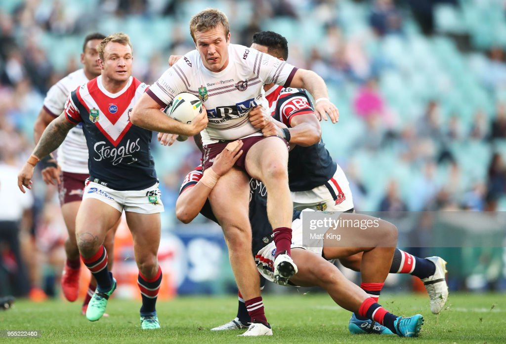 Jake Trbojevic of the Sea Eagles is tackled during the round nine NRL match between the Sydney Roosters and the Manly Warringah Sea Eagles at Allianz Stadium on May 6, 2018 in Sydney, Australia.