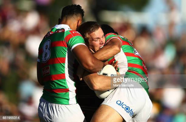 Jake Trbojevic of the Sea Eagles is tackled during the round two NRL match between the Manly Sea Eagles and the South Sydney Rabbitohs at Lottoland...