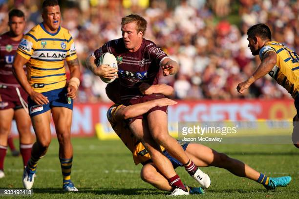 Jake Trbojevic of the Sea Eagles is tackled during the round two NRL match between the Manly Sea Eagles and the Parramatta Eels at Lottoland on March...