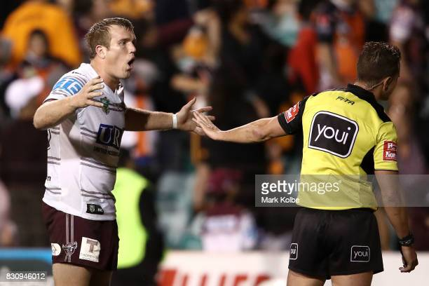 Jake Trbojevic of the Sea Eagles makes his point to the referee during the round 23 NRL match between the Wests Tigers and the Manly Sea Eagles at...