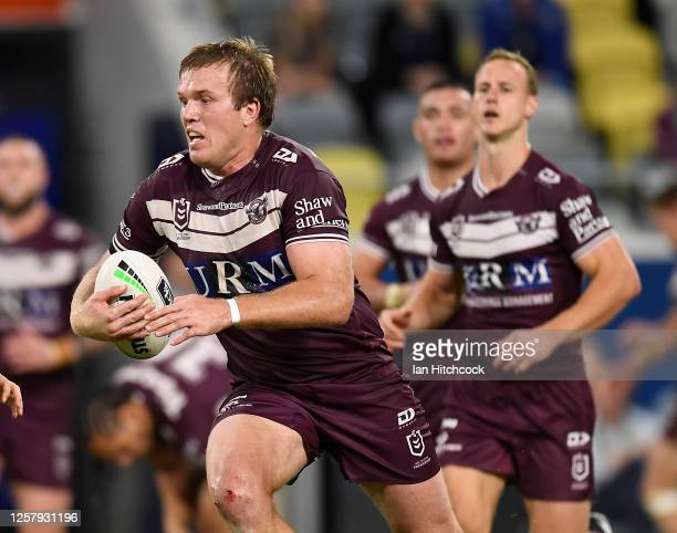 Jake Trbojevic of the Sea Eagles runs the ball during the round 11 NRL match between the North Queensland Cowboys and the Manly Warringah Sea Eagles...