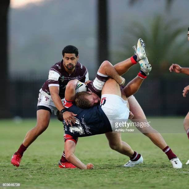 Jake Trbojevic of the Sea Eagles tackles Lindsay Collins of the Roosters during the NRL Trial match between the Manly Sea Eagles and the Sydney...