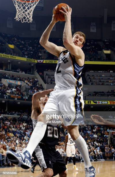 Jake Tsakalidis of the Memphis Grizzlies pulls down a rebound during a game between the San Antonio Spurs and the Memphis Grizzlies on February 24...