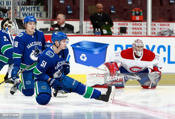 Jake Virtanen and Troy Stecher of the Vancouver Canucks and Carey Price of the Montreal Canadiens stretch during their NHL game at Rogers Arena...