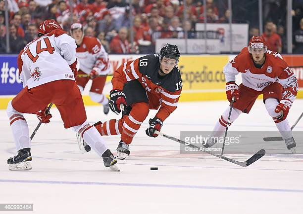 Jake Virtanen of Team Canada looks to break up a pass against Team Denmark during a quarterfinal game in the 2015 IIHF World Junior Hockey...
