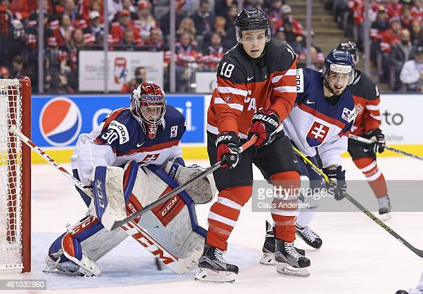 Jake Virtanen of Team Canada looks to tip a shot on Denis Godla of Team Slovakia during a semifinal game in the 2015 IIHF World Junior Hockey...