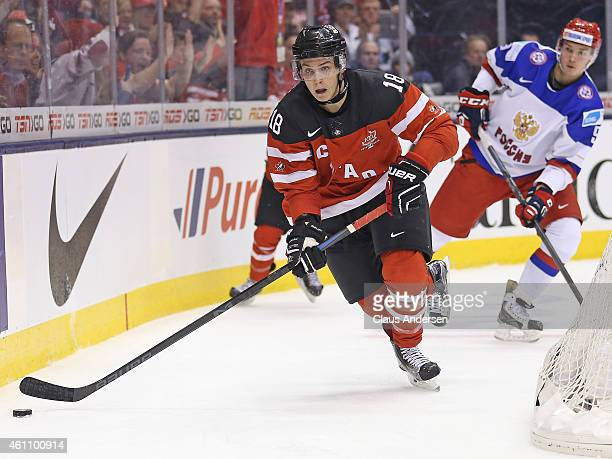 Jake Virtanen of Team Canada skates with the puck against Team Russia during the gold medal game in the 2015 IIHF World Junior Hockey Championship at...