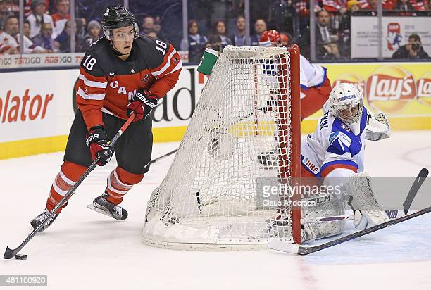 Jake Virtanen of Team Canada tries a wrap around on Ilya Sorokin of Team Russia during the gold medal game in the 2015 IIHF World Junior Hockey...