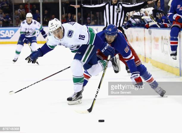 Jake Virtanen of the Vancouver Canucks attempts to get past Rick Nash of the New York Rangers during the third period at Madison Square Garden on...