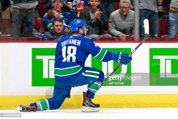 Jake Virtanen of the Vancouver Canucks celebrates after scoring during their NHL game against the Calgary Flames at Rogers Arena October 3 2018 in...