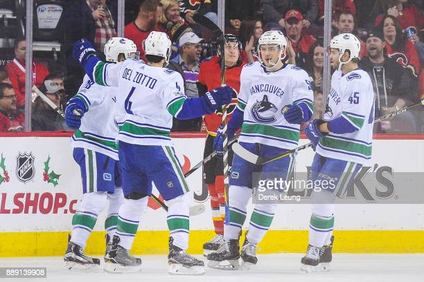 Jake Virtanen of the Vancouver Canucks celebrates with his teammates after scoring against the Calgary Flames during an NHL game at Scotiabank...