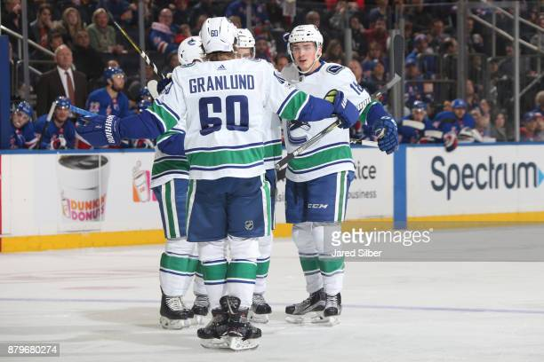 Jake Virtanen of the Vancouver Canucks celebrates with Markus Granlund and Michael Del Zotto after scoring a goal in the second period against the...