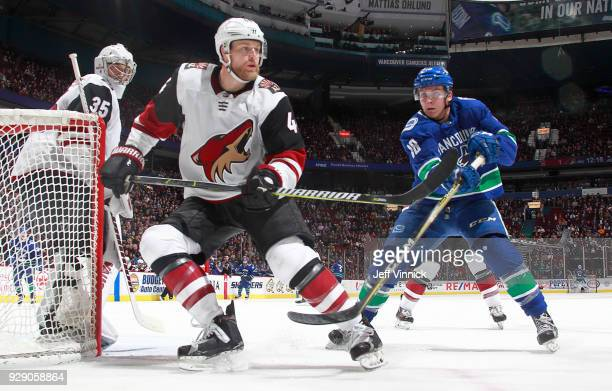 Jake Virtanen of the Vancouver Canucks chases Niklas Hjalmarsson of the Arizona Coyotes during their NHL game at Rogers Arena March 7 2018 in...