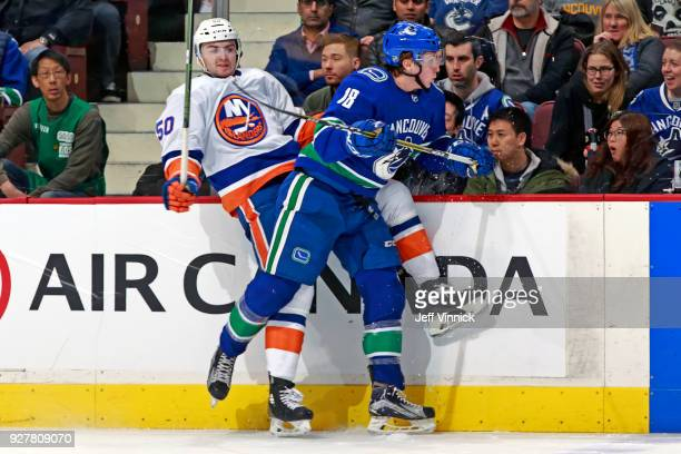 Jake Virtanen of the Vancouver Canucks checks Adam Pelech of the New York Islanders during their NHL game at Rogers Arena March 5 2018 in Vancouver...