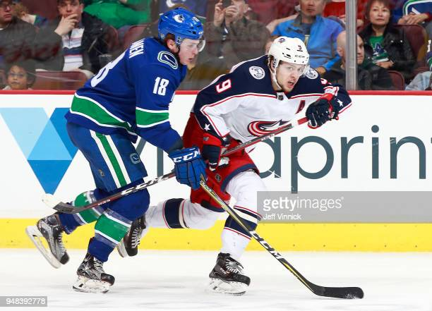 Jake Virtanen of the Vancouver Canucks checks Artemi Panarin of the Columbus Blue Jackets during their NHL game at Rogers Arena March 31 2018 in...