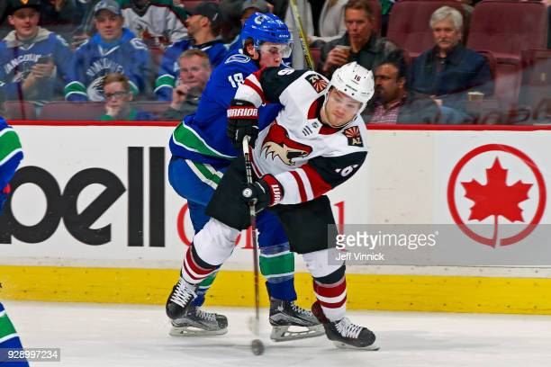 Jake Virtanen of the Vancouver Canucks checks Max Domi of the Arizona Coyotes during their NHL game at Rogers Arena March 7 2018 in Vancouver British...