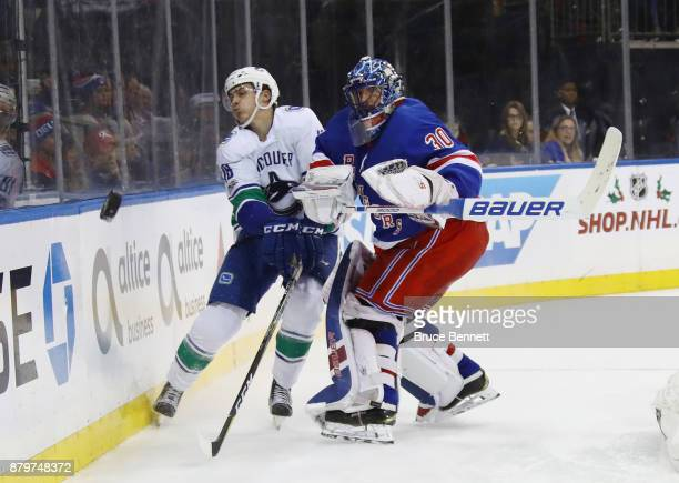 Jake Virtanen of the Vancouver Canucks collides with Henrik Lundqvist of the New York Rangers during the third period at Madison Square Garden on...