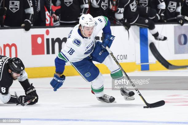 Jake Virtanen of the Vancouver Canucks handles the puck during a game against the Los Angeles Kings at STAPLES Center on March 12 2018 in Los Angeles...