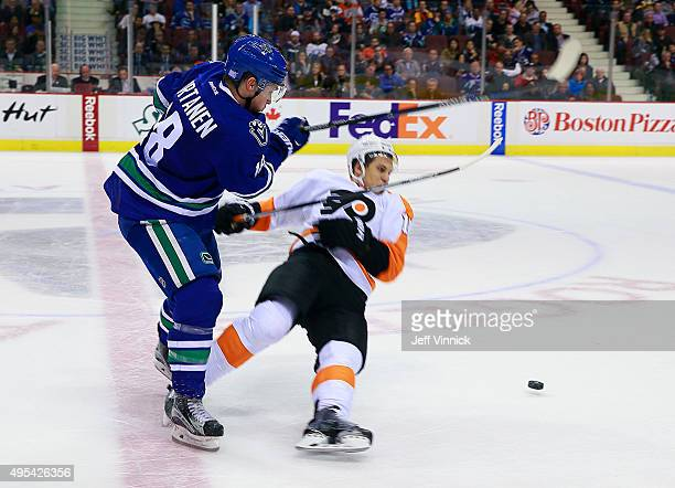 Jake Virtanen of the Vancouver Canucks hits Brayden Schenn of the Philadelphia Flyers during their NHL game at Rogers Arena November 2 2015 in...