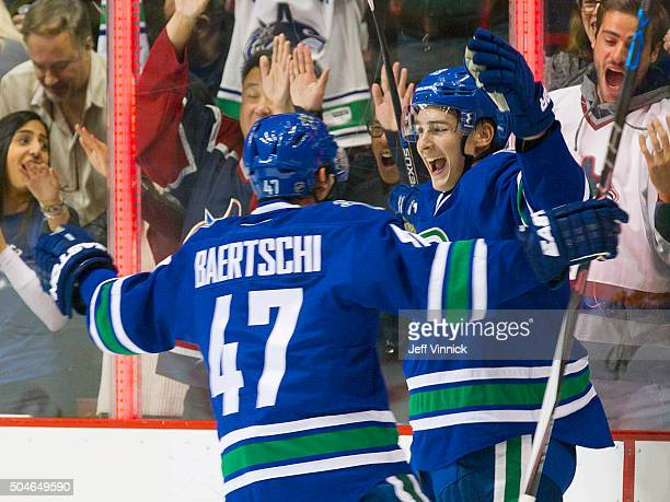 Jake Virtanen of the Vancouver Canucks is congratulated by teammate Sven Baertschi after scoring during their NHL game against the Florida Panther at...