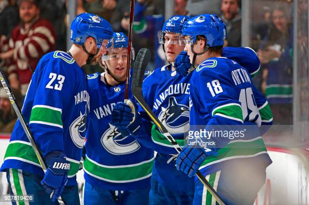 Jake Virtanen of the Vancouver Canucks is congratulated by teammates after scoring during their NHL game against the New York Islanders at Rogers...