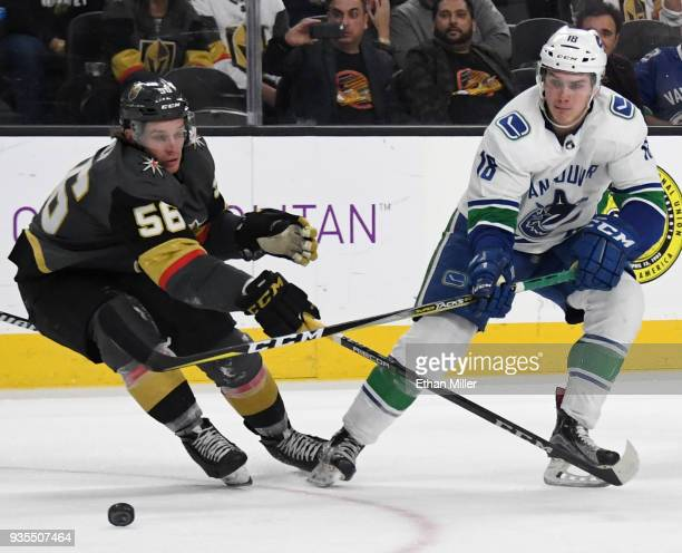 Jake Virtanen of the Vancouver Canucks passes against Erik Haula of the Vegas Golden Knights in the third period of their game at TMobile Arena on...