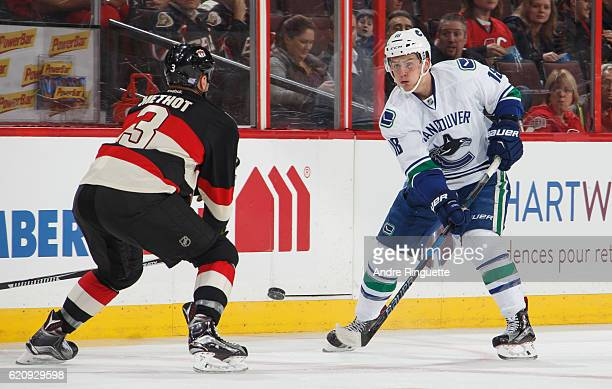 Jake Virtanen of the Vancouver Canucks passes the puck against Marc Methot of the Ottawa Senators at Canadian Tire Centre on November 3 2016 in...