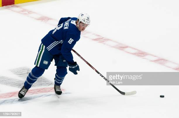 Jake Virtanen of the Vancouver Canucks receives a pass skates on the first day of the Vancouver Canucks NHL Training Camp on January 2021 at Rogers...